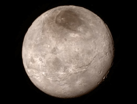 Remarkable new details of Pluto's largest moon Charon are revealed in this image from New Horizons' Long Range Reconnaissance Imager (LORRI), taken late on July 13, 2015 from a distance of 289,000 miles  (466,000 kilometers).