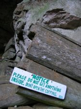 """There are burial caves near the cliff as well. """"Notice: Please do not get anything inside. Don't open the coffins"""""""