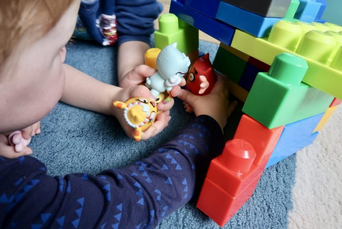 Children playing with plastic figures from the Love Monster TV show