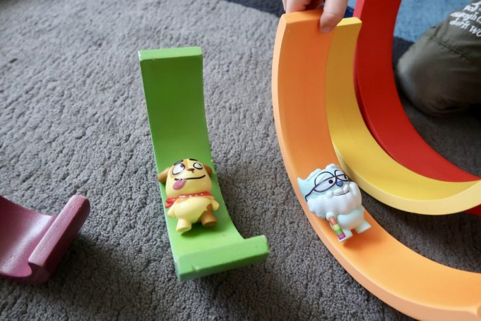Fluffy Town toys being play with parts of a wooden rainbow