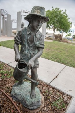 Small Boy with Hat and Watering Can