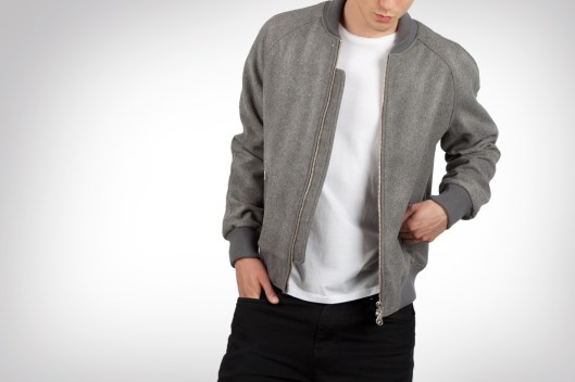 This unconventional MKI varsity jacket has a zipper closure and no contrasting sleeves.