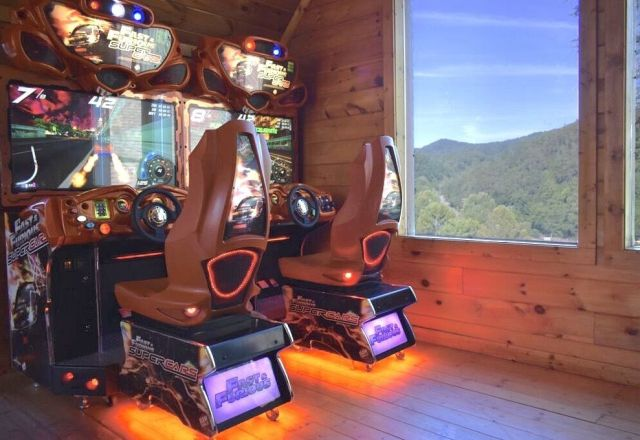 These elite gaming machines with huge HD flat screens, force feedback steering wheels, and surround sound are incredibly fun to play. - Race a friend or family member through the hills of New England or the streets of Tokyo, the incredible graphics make you feel like you are there.