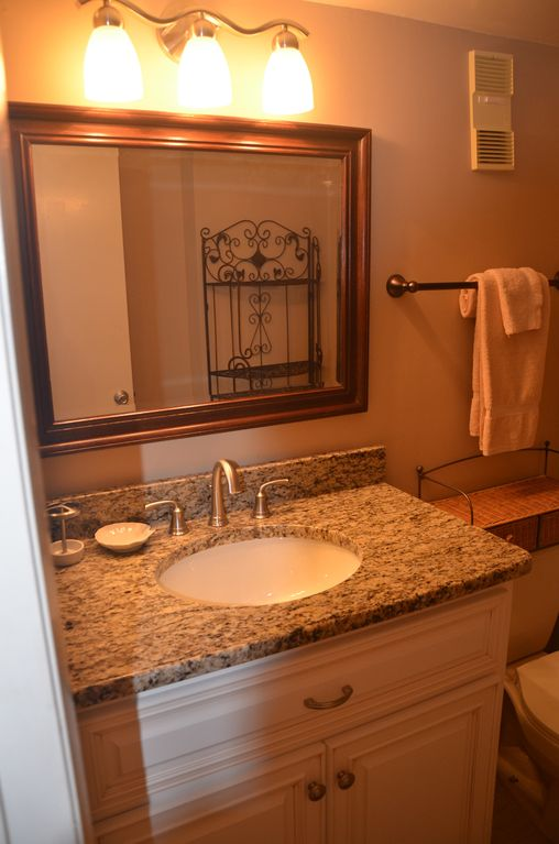 ... Bathroom · Brand New Upgrades Include New Tile, New Carpet And