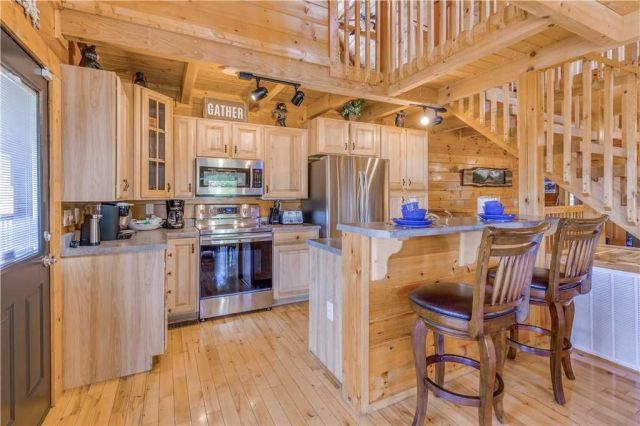 The kitchen is a chef's delight - In addition to the usual gamut of appliances, cookware, and tableware, the kitchen includes a Keurig coffee system, a crockpot, and a griddle for whipping up pancakes in the morning.