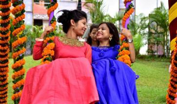 Two young girls enjoying Raja Festival at OTDC in Bhubaneswar on Thursday
