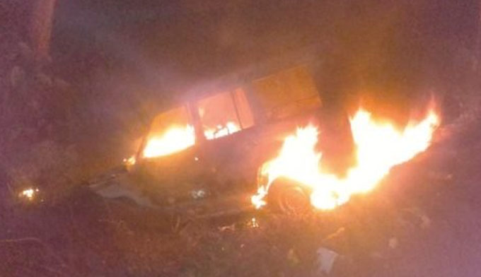 police van gutted into ash