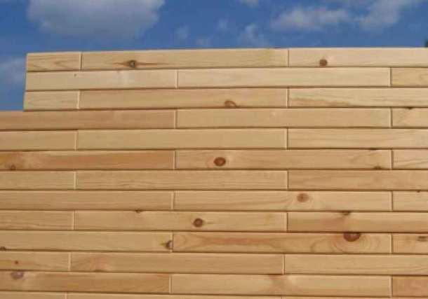 Кладка деревянного кирпича