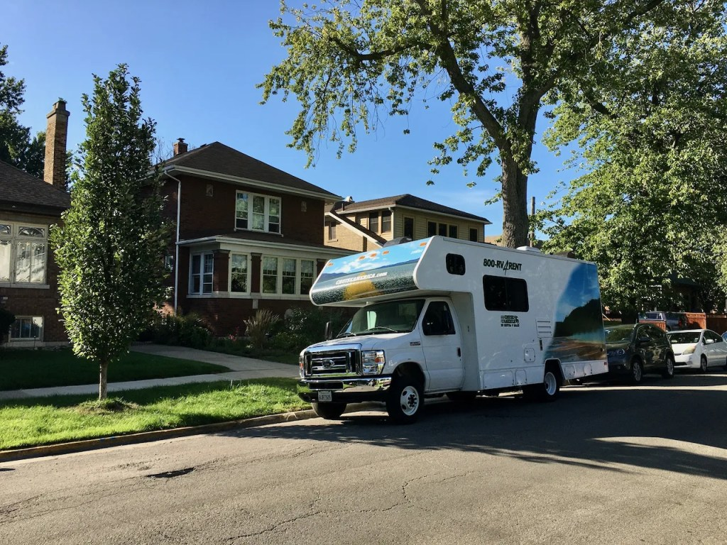 Our Cruise America rental RV parked in front of our house.