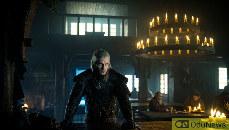 Henry Cavill stars as the burly, sullen hero who must find and protect a young girl