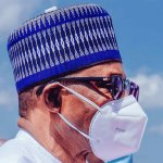 [PHOTOS] Buhari Dons Face Mask For The First Time