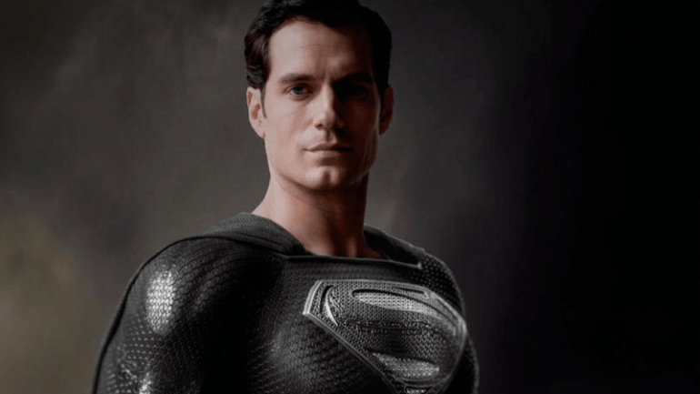 Henry Cavill as Superman wearing a black suit