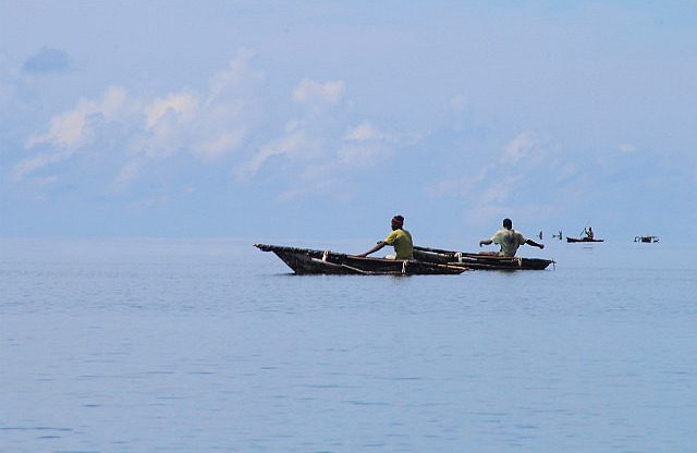 fishermen in their tiny boats