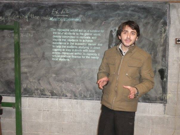 Mr Karim conducting a presentation during an oec educational expo in Ghizer