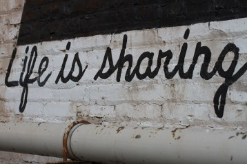 """Part of a Cleveland mural, the full saying was """"Life is sharing a park bench"""""""