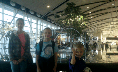 Three children in front of the Detroit Metro Airport fountain