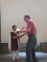 Savita Devi receiving prize from Prof. Richard Lucius in Berlin 2013