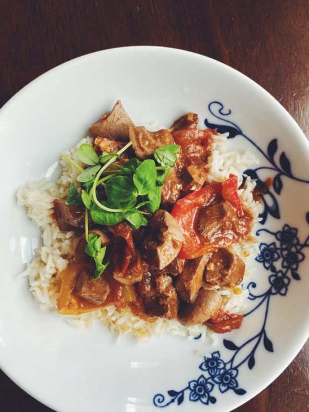 Pork Kidney Stir-Fry with Tomatoes and Bell Pepper served over rice
