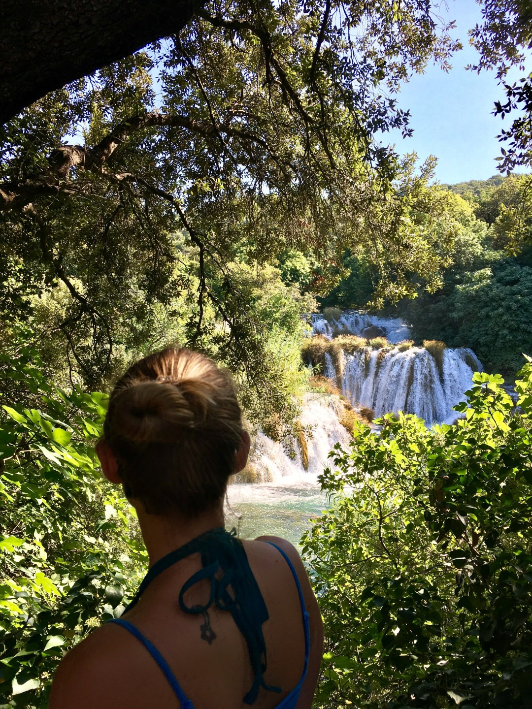 Girl looks out over the waterfalls at Krka National Park in Croatia