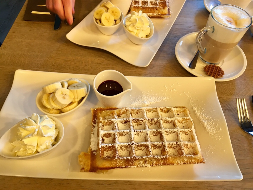 Belgian waffles with chocolate sauce and bananas