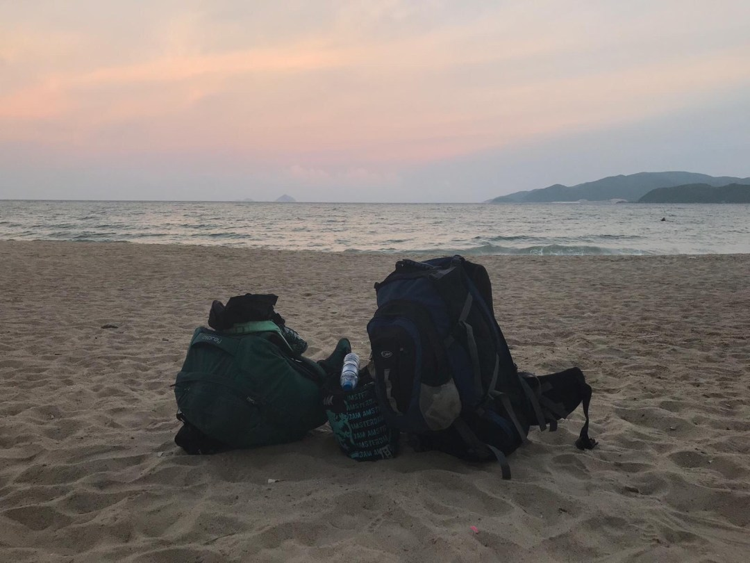 backpacks on beach in Nha Trang at sunset