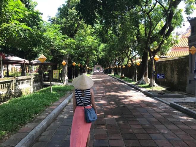 Exploring Hue Imperial City Vietnam in conical hat, or non la