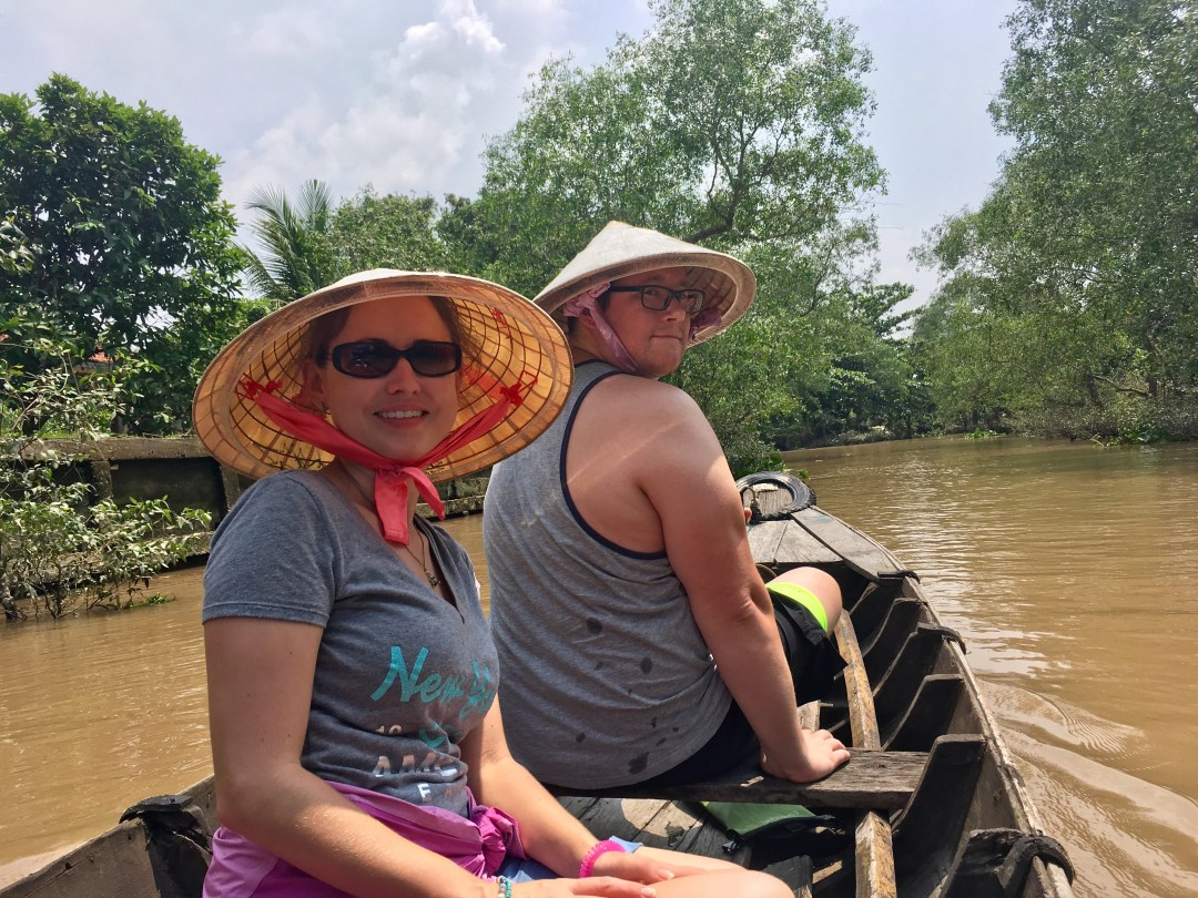 Couple in Bamboo boat on Mekong Delta