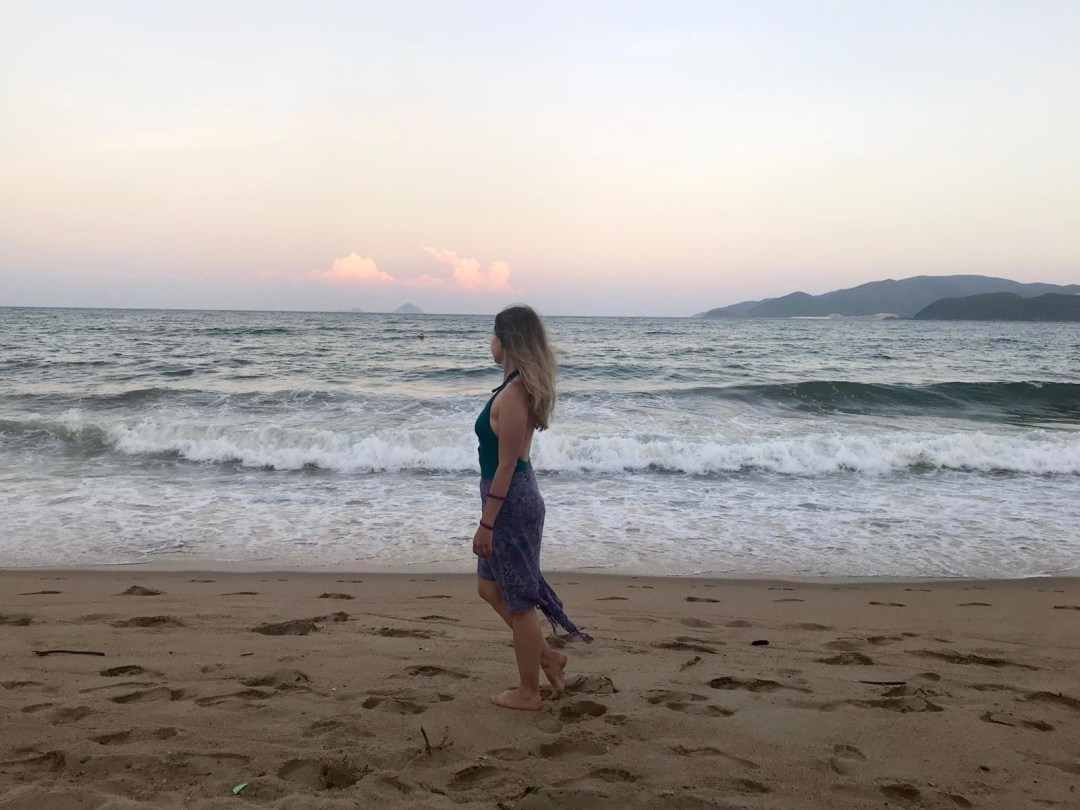 Girl on beach at sunset in Nha Trang