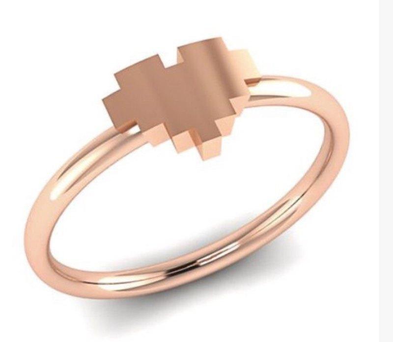 Loving this nerdy rose gold 8-bit heart ring --- very Legend of Zelda, right?