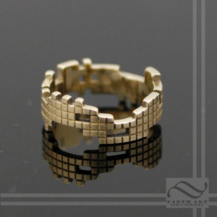 Yep, it's a solid gold Tetris ring!