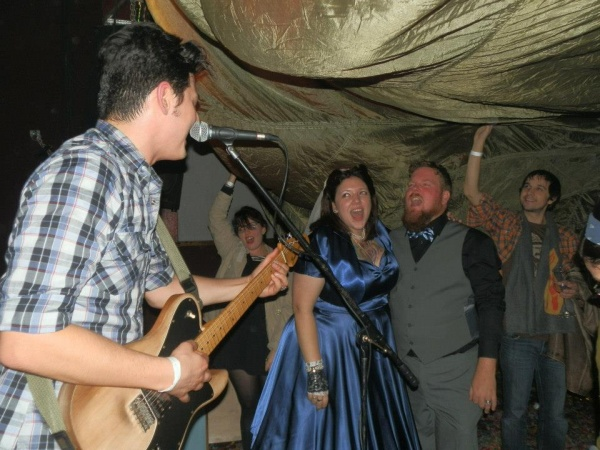 Tribesmaid Dreemwhrld and her new husband Thad belted it out at their favorite bar with the band playing the same song that was playing when Thad proposed. D'aww. Photo by Amy Gattis