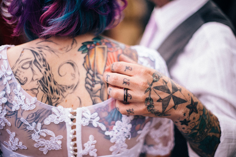 A tattoo artist and his tattoo bride at this Tacoma wedding