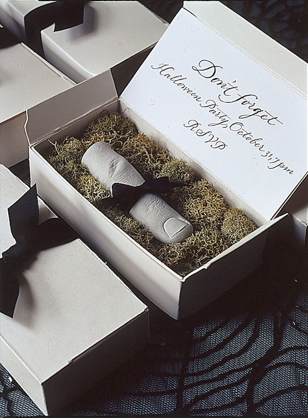 Creep your guests out with a severed finger save-the-date