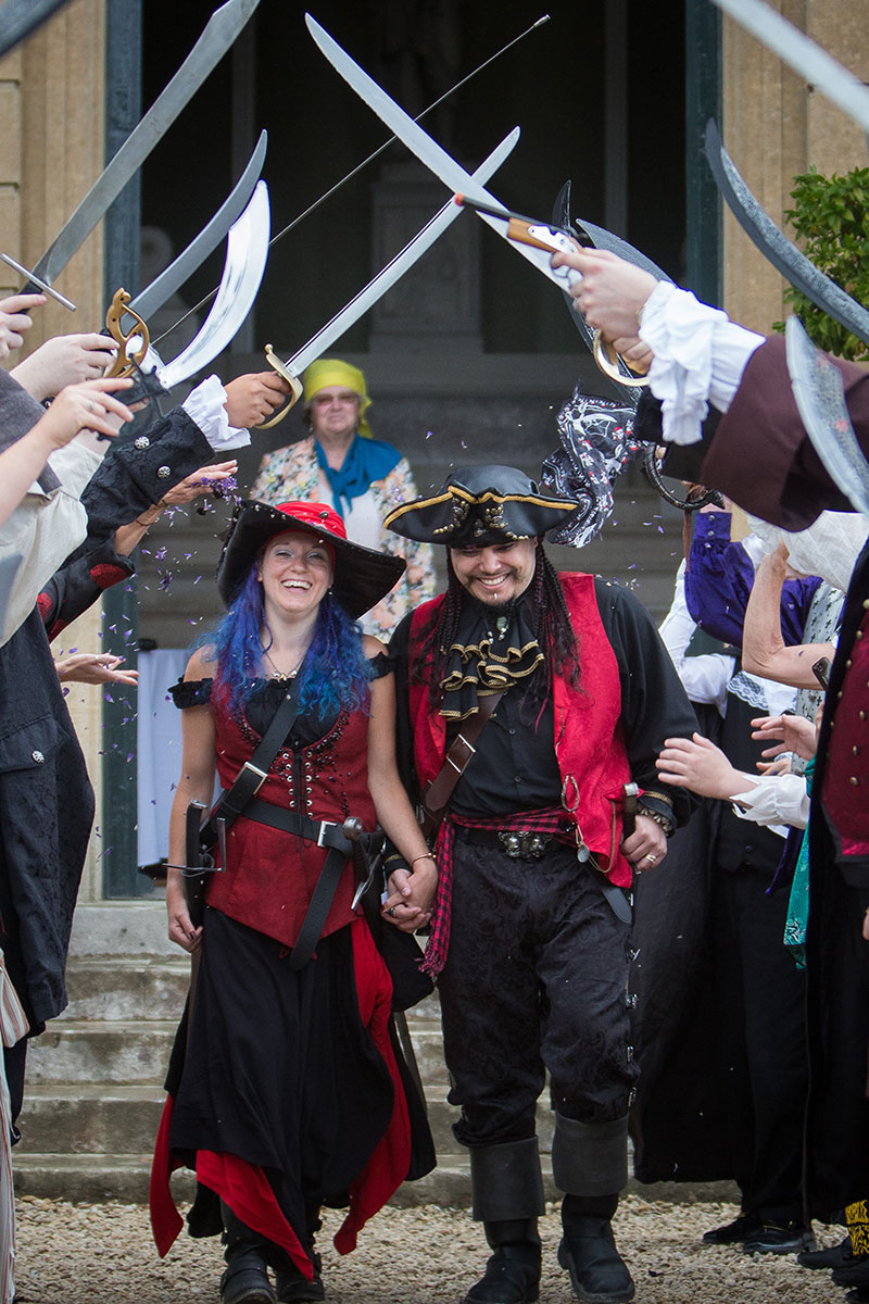 It's not a pirate sword fighting wedding without vegan food and blue hair!