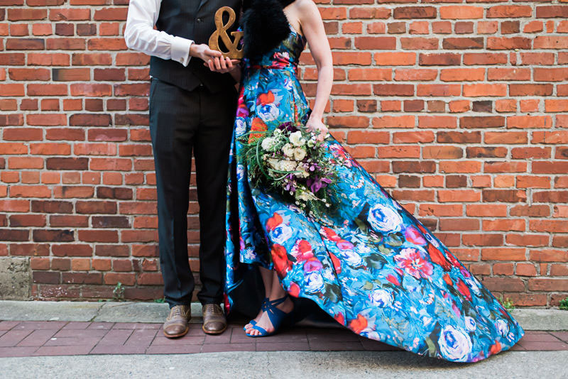 A chic elopement in Vancouver with a floral wedding dress and a toy robot