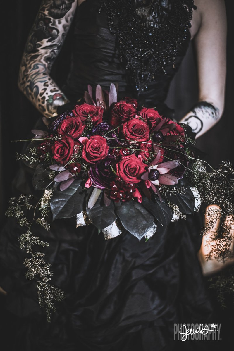 Goth gone LUXE with sparkle, faux fur, and rich reds at this goth wedding inspiration