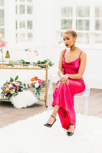 Be blown away by the stunning hot pink dress at this greenhouse elopement shoot