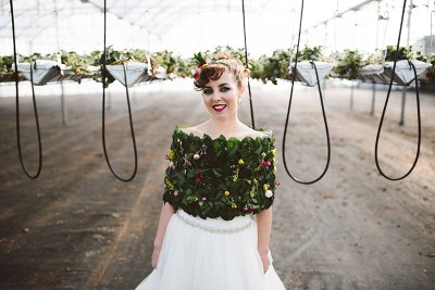 Don't miss the greenery shawl at this Mid-Century Modern wedding right in the middle of a strawberry field