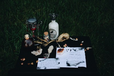 A witchy elopement with a black dress, dark watercolors, and a cleansing stick bouquet
