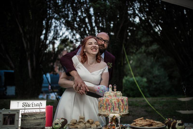 This outdoor carousel wedding had rainbow decor and a doggy bridesmaid