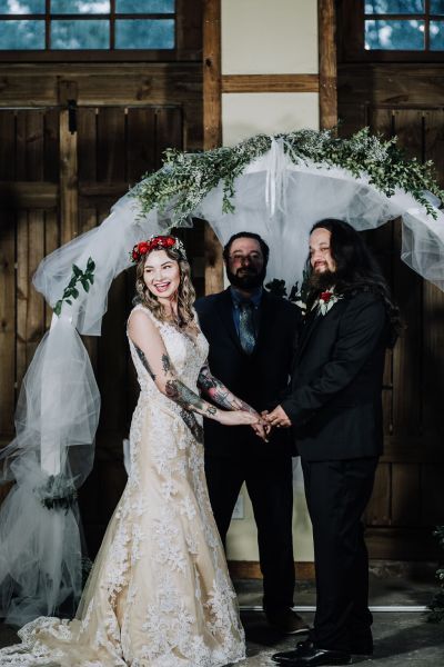Ink, roses, & tequila shots at this goth meets spring wedding at Lafitte Street Market