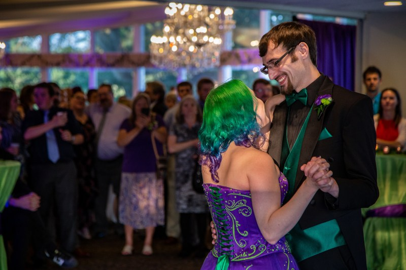 Arcade games & epic foliage at this whimsical green & purple wedding