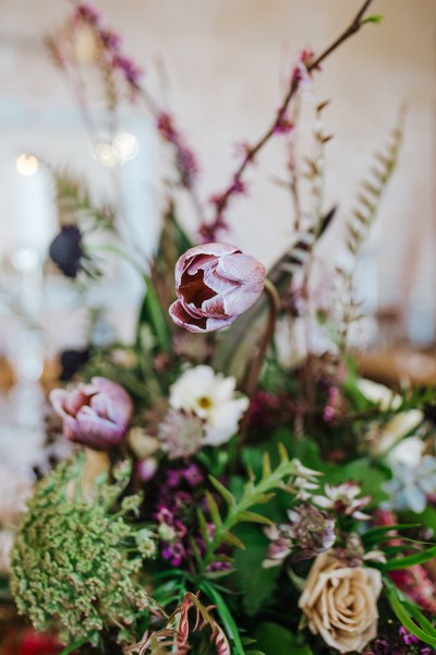 So much edgy floral goodness at this urban art + distillery wedding inspiration