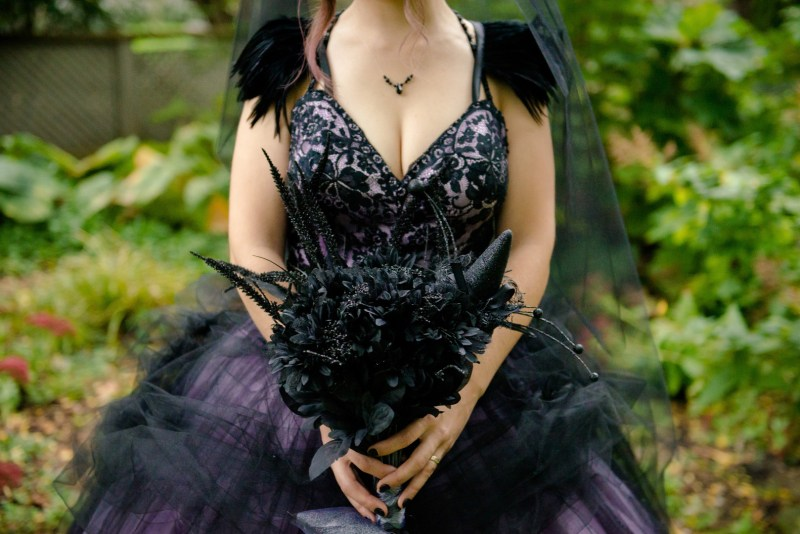 A Hallowedding costume party with a gorgeous purple and black gown