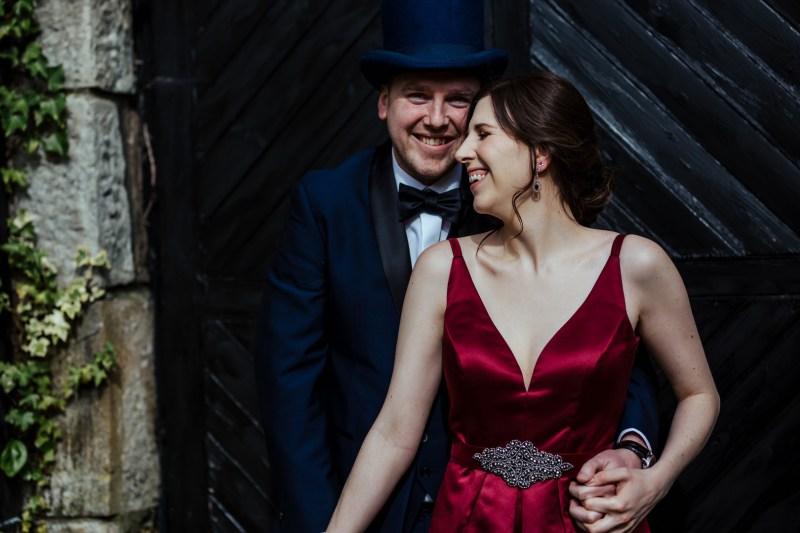An Irish castle wedding with Victorian flair & a stunning red dress
