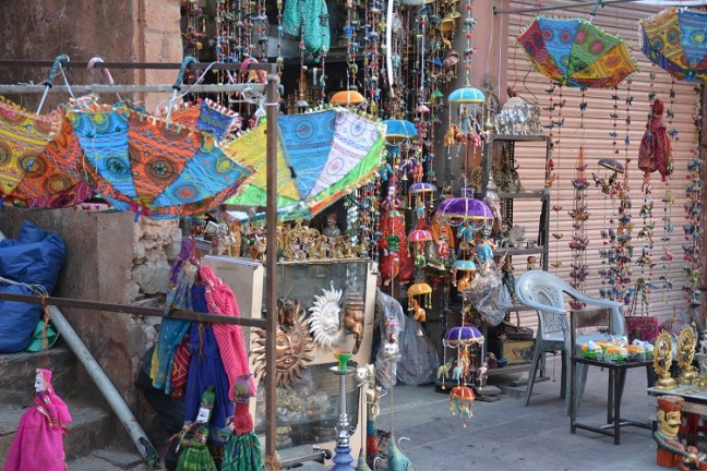 Puppets, handicrafts and colours at shops outside Hawa Mahal Jaipur