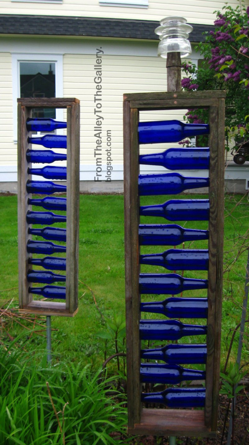 Blue Beer bottle ladder garden art idea from Etsy seller ShelleyHolm