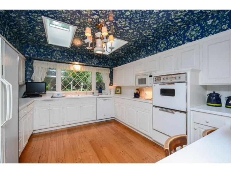 It's hard to have wallpaper in a kitchen... unless you put it on the ceiling!