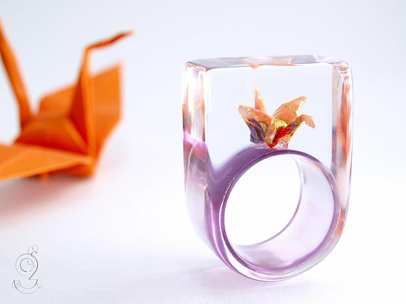 Tiny worlds reside in these intricate resin rings
