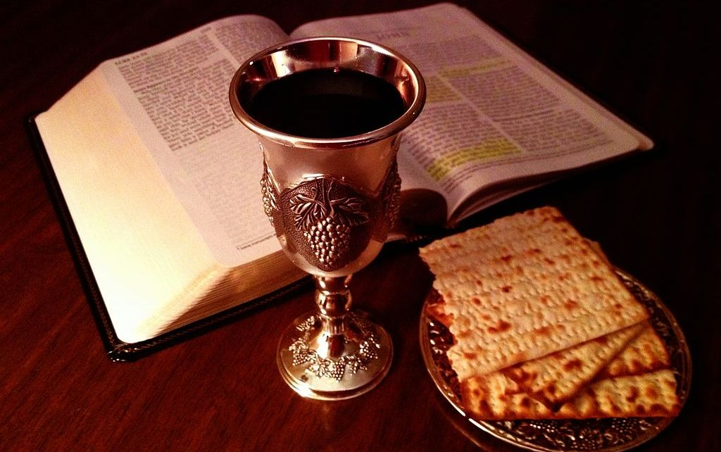Torah, wine goblet and matzo bread